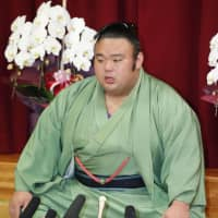 Kyushu Grand Sumo Tournament champion Takakeisho speaks during a news conference on Monday morning in Fukuoka. | KYODO