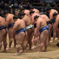 Top ranked wrestlers bow during the JSA shonichi greeting before the March 2017 tournament in Osaka. | JOHN GUNNING