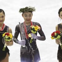 Silver medalist Satoko Miyahara (left), gold medalist Rika Kihira (center) and third-placed finisher Elizaveta Tuktamysheva of Russia pose for a photo during an awards ceremony at the NHK Trophy in Hiroshima on Saturday. | AP