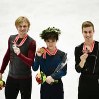 Silver medalist Sergei Voronov of Russia (left), winner Shoma Uno (center) and Italy's bronze medalist Matteo Rizzo display their medals after the men's free skate at the NHK Trophy. | AFP-JIJI