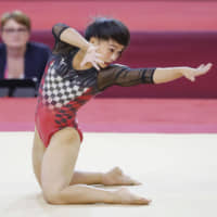 Gymnast Mai Murakami performs her floor routine on Saturday at the world championships in Doha. | KYODO