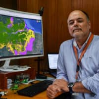 Claudio Almeida, coordinator of the Amazon Program, poses for a picture at the National Institute for Space Research headquarters in Sao Jose dos Campos, 90 km north of Sao Paulo.  | AFP-JIJI