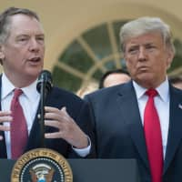U.S. Trade Rep. Robert Lighthizer speaks next to U.S. President Donald Trump, remarking on the United States, Mexico, Canada Agreement (USMCA), from the Rose Garden of the White House in Washington Oct. 1. The U.S. negotiator in charge of trade talks with China said Sunday he considers March 1 to be a 'hard deadline' for reaching an agreement that would avert an intensifying trade war. | AFP-JIJI