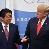 Prime Minister Shinzo Abe speaks with U.S. President Donald Trump during a meeting in the sidelines of the Group of 20 summit in Buenos Aires on Friday. | AFP-JIJI