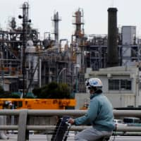 The Keihin industrial zone is seen in Kawasaki. Japan's economy shrank more than expected in the July-September quarter, according to government data. | REUTERS
