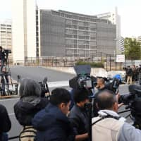 The Tokyo District Court on Thursday rejected a request from prosecutors to extend the detention of former Nissan Motor Co. Chairman Carlos Ghosn at the Tokyo Detention Center, pictured. | AFP-JIJI