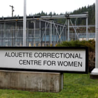 A sign of the Alouette Correctional Centre for Women, where Huawei CFO Meng Wanzhou is being held on an extradition warrant, is seen outside the facility in Maple Ridge, British Columbia, on Saturday, | REUTERS