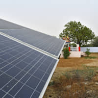 A bank of solar panels has been installed in a village on the outskirts of Alwar, Rajasthan, in northwest India. | BLOOMBERG