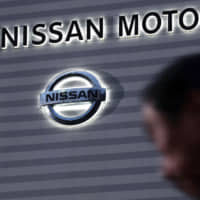 Greg Kelly, a former Nissan Motor Co. representative director who was first arrested on Nov. 19, was served a fresh arrest warrant along with former Chairman Carlos Ghosn on Monday. | KYODO