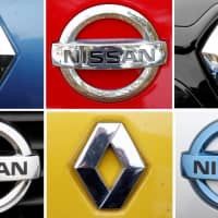 A combination picture shows logos of Japan's Nissan and France's Renault on cars in Strasbourg, eastern France, in 2012.   REUTERS