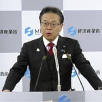 Japanese economy minister returns salary over pay offer to government-backed fund that was 'too high'