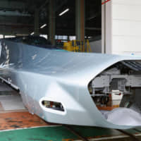 Car No. 1 of the ALFA-X, the next generation of shinkansen, is shown to the media Wednesday at a production factory in Kobe. East Japan Railway Co. will trial the ALFA-X, which will boast a top operational speed of 360 kph, on the Tohoku Shinkansen line after its production is completed in May. | KYODO