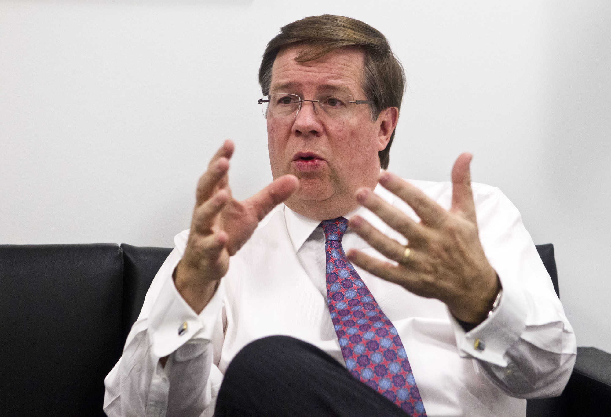 Toyota North America CEO Jim Lentz speaks during an interview at the North American International Auto Show in Detroit in 2016. Lentz told the Detroit Economic Club Wednesday that car sales fell below 30 percent of sales last month, and he thinks that's close to the bottom.   AP