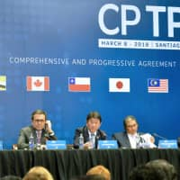 Economic Revitalization Minister Toshimitsu Motegi (center) answers questions during a news conference in Santiago in March. | KYODO