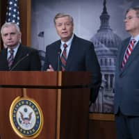 Sens. (from left) Jack Reed, D-R.I., Lindsey Graham, R-S.C., members of the Senate Armed Services Committee, and Bob Menendez, D-N.J., the ranking member of the Senate Foreign Relations Committee, are disagreeing with President Donald Trump's sudden decision to pull all 2,000 U.S. troops out of Syria, during a news conference at the Capitol in Washington Thursday. | AP