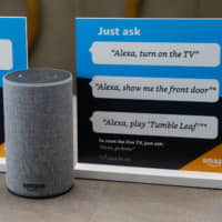 Prompts on how to use Amazon's Alexa personal assistant are displayed in an Amazon 'experience center' in Vallejo, California, in May. | REUTERS