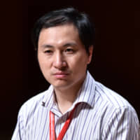 Chinese scientist He Jiankui holds a panel discussion after speaking at the Second International Summit on Human Genome Editing in Hong Kong on Nov. 28. | AFP-JIJI