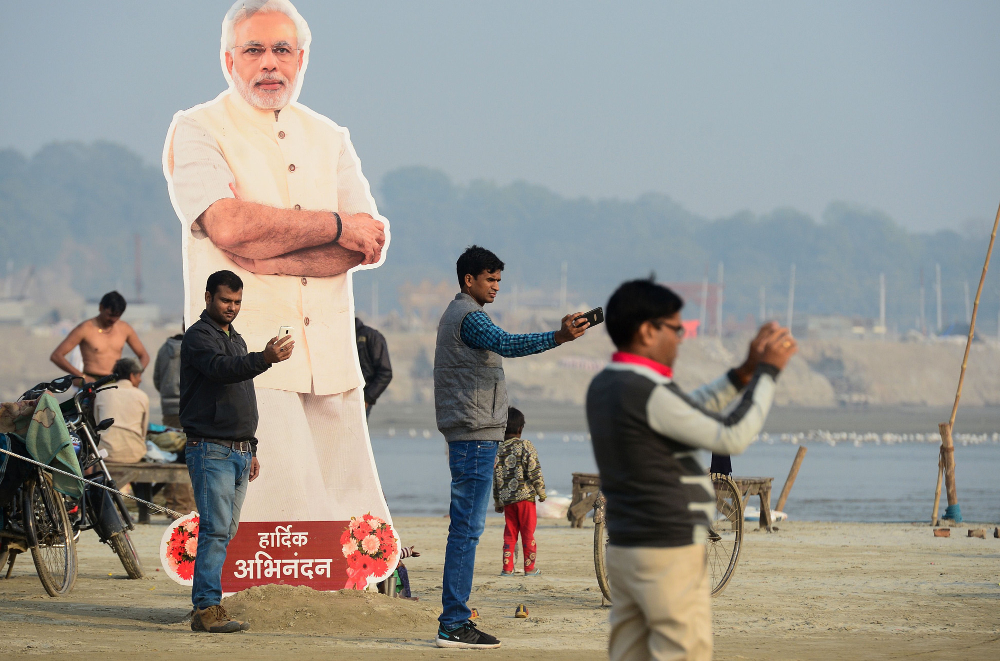 A cardboard cut-out of Indian Prime Minister Narendra Modi stands at the Kumbh Mela festival area in Allahabad on Thursday. The  event attracts millions of Hindu pilgrims to the sacred confluence of the Yamuna and Ganges rivers, where they will take ritual baths over 49 days from Jan. 15 until March 4. | AFP-JIJI