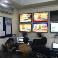 Congress party volunteers monitor TV news channels and social media platforms inside an operations room in Jaipur on Dec. 3 ahead of a Rajasthan state assembly election. | REUTERS