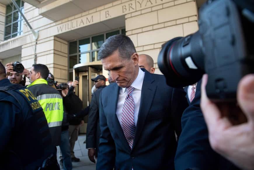 Former National Security Advisor Gen. Michael Flynn leaves after the delay in his sentencing hearing at U.S. District Court in Washington Tuesday. President Donald Trump's former national security chief Flynn received a postponement of his sentencing after an angry judge threatened to give him a stiff sentence. | AFP-JIJI
