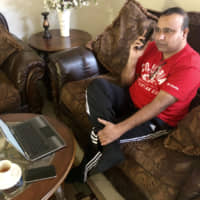 Madhu Bellam, a member of the Overseas Friends of BJP, calls potential voters in Hyderabad, India, from his home in Clarksburg, Maryland, on Dec. 2. | REUTERS