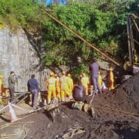 Rescuers work at the site of a coal mine that collapsed in Ksan, in the northeastern state of Meghalaya, India, Sunday. | REUTERS