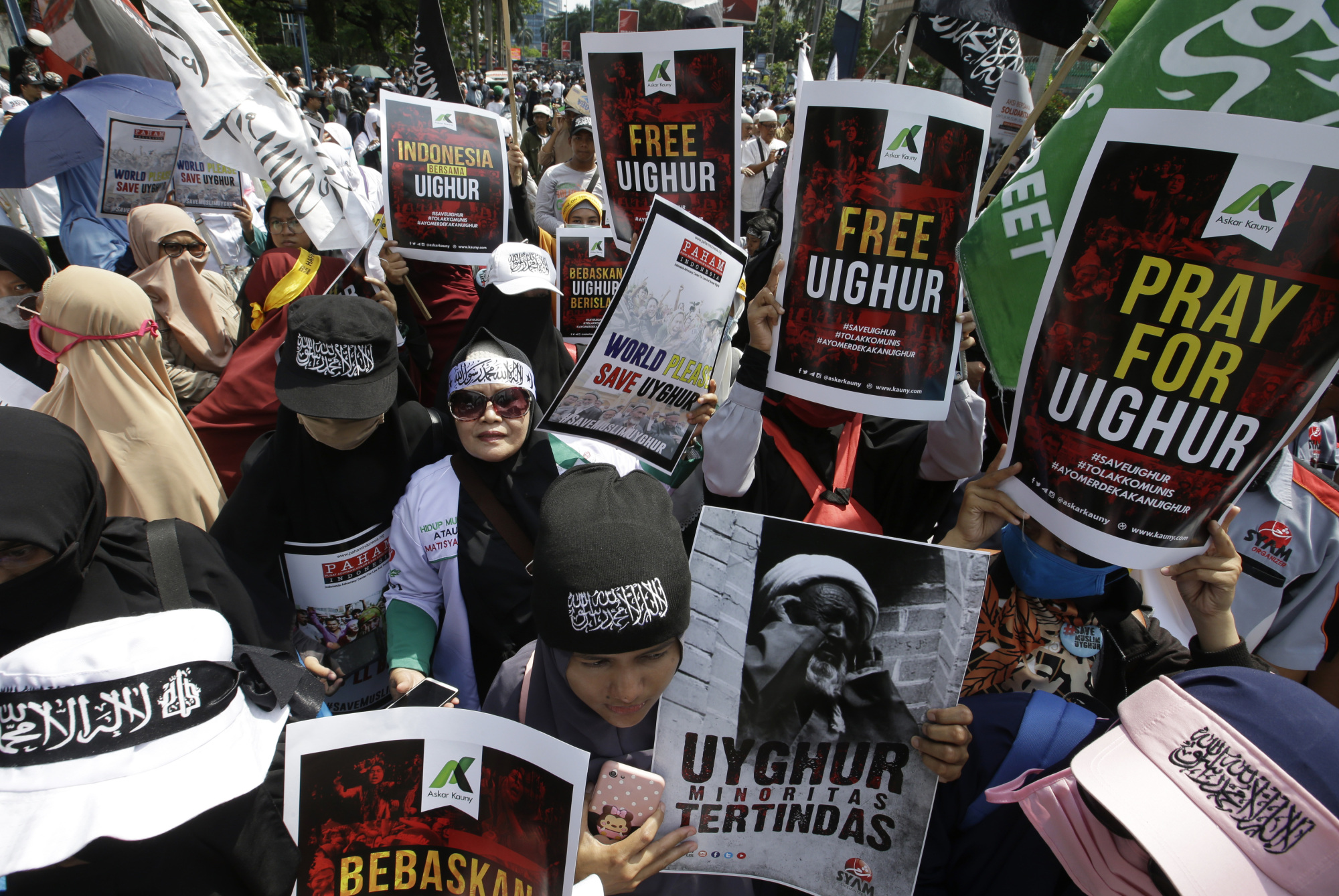 Muslim protesters rally outside the Chinese Embassy in Jakarta, Indonesia, on Friday, | AP