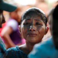 Claudia Maquin, mother of Jakelin Caal, a 7-year-old girl who handed herself in to U.S. border agents earlier this month and died after developing a high fever while in the custody of U.S. Customs and Border Protection, reacts during her daughter's funeral at her home village of San Antonio Secortez, in Guatemala, Tuesday. | REUTERS