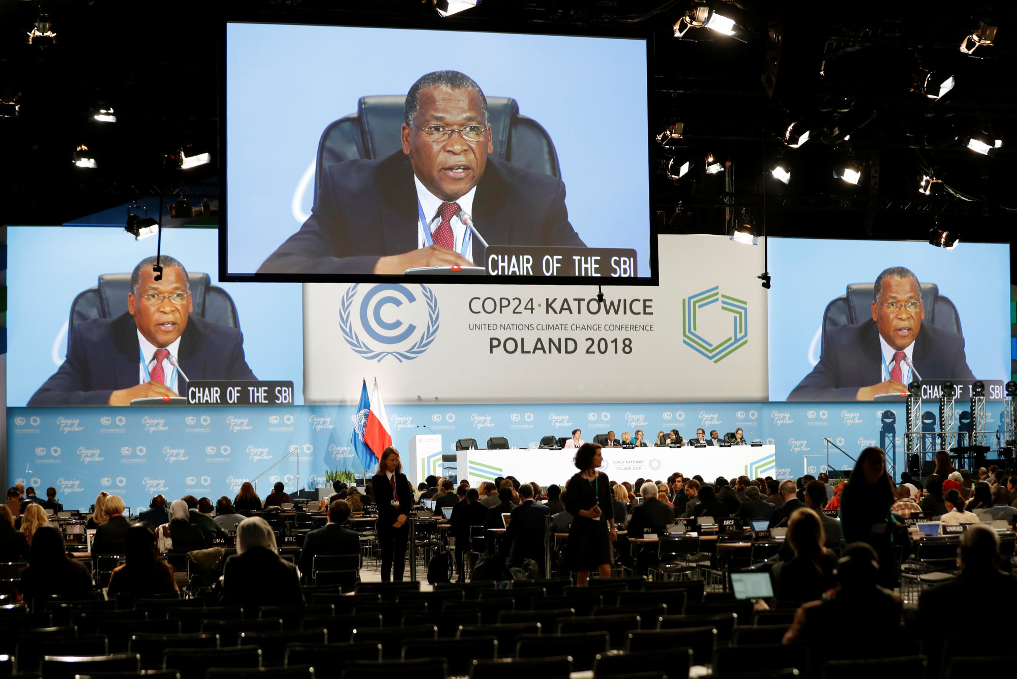 SBI chairman Emmanuel Dumisani Dlamini is seen on giant screens during the COP24 U.N. Climate Change Conference 2018 in Katowice, Poland, Sunday. | REUTERS
