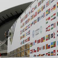 Workers decorate the venue of the global climate summitat the site of the closed Katowice coal mine in the city of Katowice, Poland, last month. | AP
