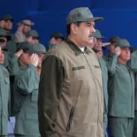 Venezuelan President Nicolas Maduro attends the end of the year ceremony with members of the Bolivarian National Armed Forces in Caracas Friday. | MIRAFLORES PALACE / HANDOUT / VIA REUTERS