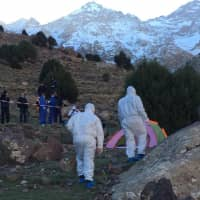 In this photo provided by Moroccan news channel 2M and taken on Tuesday, a forensic team is seen at the area where the bodies of two Scandinavian women tourists were found, near Imlil in the High Atlas mountains, Morocco. The lone suspect arrested in the killings is connected to a terrorist group, and three other suspects are on the run, Moroccan prosecutors said Wednesday. | 2M / VIA AP