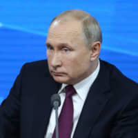 Russian President Vladimir Putin holds his annual news conference in Moscow on Thursday. | BLOOMBERG