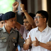 Detained Reuters journalist Wa Lone and Kyaw Soe Oo arrive at Insein court in Yangon, Myanmar, on Aug. 27. | REUTERS