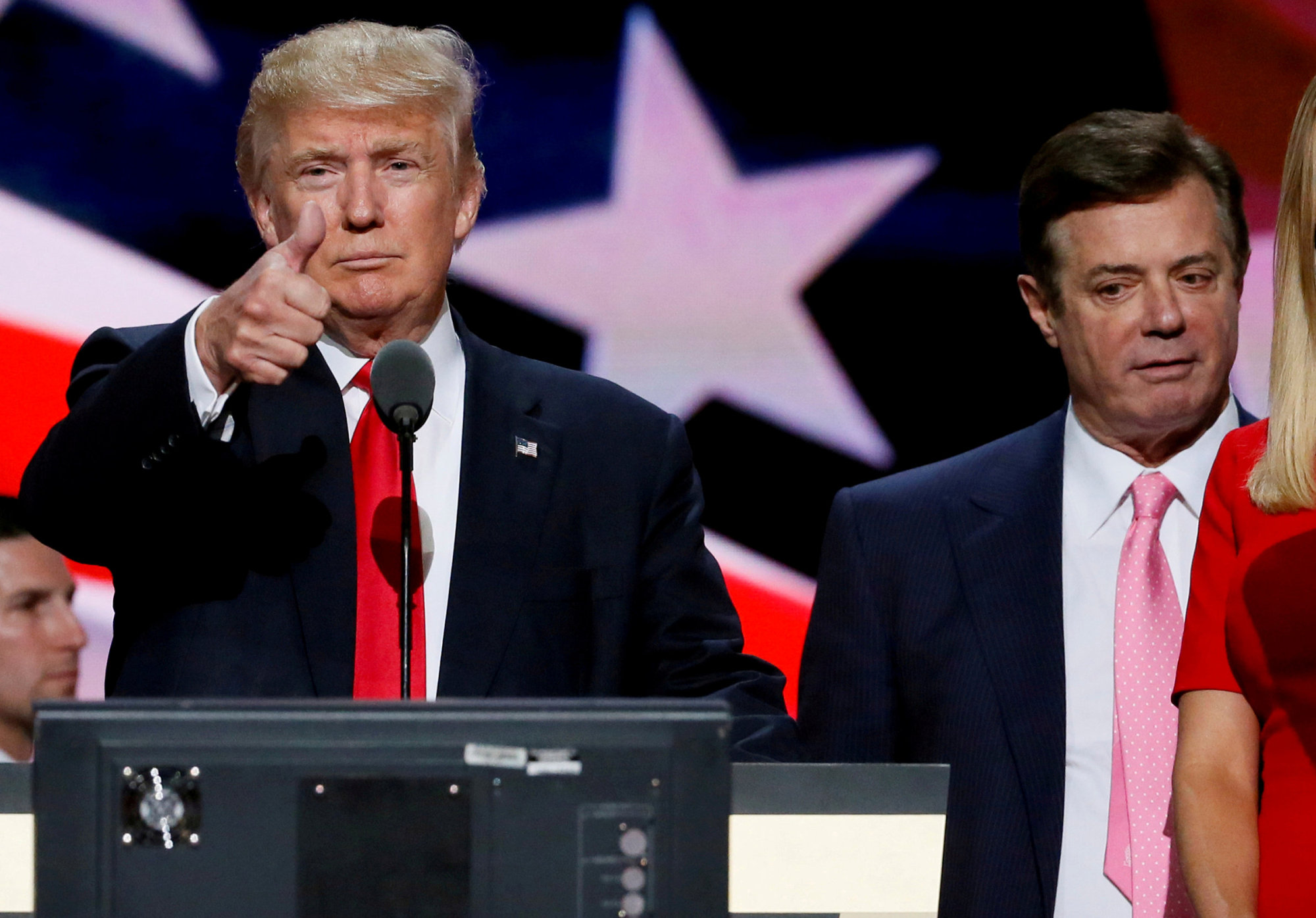 Then-Republican presidential nominee Donald Trump gives a thumbs up as his campaign manager, Paul Manafort, looks on during Trump's walk-through at the Republican National Convention in Cleveland in 2016. | REUTERS