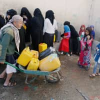 People collect drinking water from a charity tap amid fears of a new cholera outbreak in Sanaa Nov. 5. | REUTERS