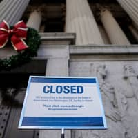 A sign declares the National Archive is closed due to a partial federal government shutdown in Washington on Saturday. | REUTERS