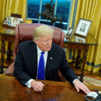 U.S. President Donald Trump answers questions during for an exclusive interview with Reuters journalists in the Oval Office at the White House in Washington on Tuesday. | REUTERS