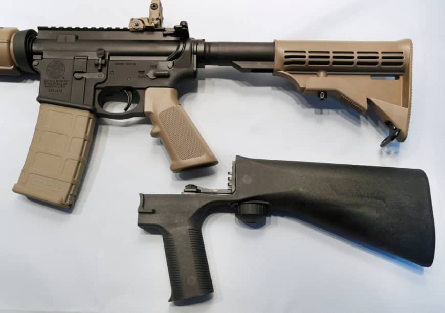 A bump fire stock that attaches to a semiautomatic rifle to increase the firing rate is seen at Good Guys Gun Shop in Orem, Utah, in 2017. | REUTERS
