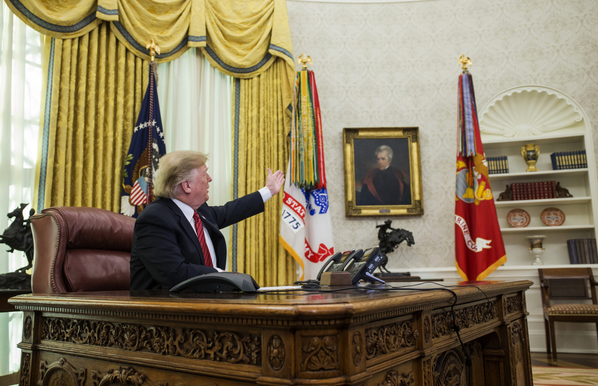 U.S. President Donald Trump speaks in the Oval Office at the White House in Washington on Tuesday. | BLOOMBERG