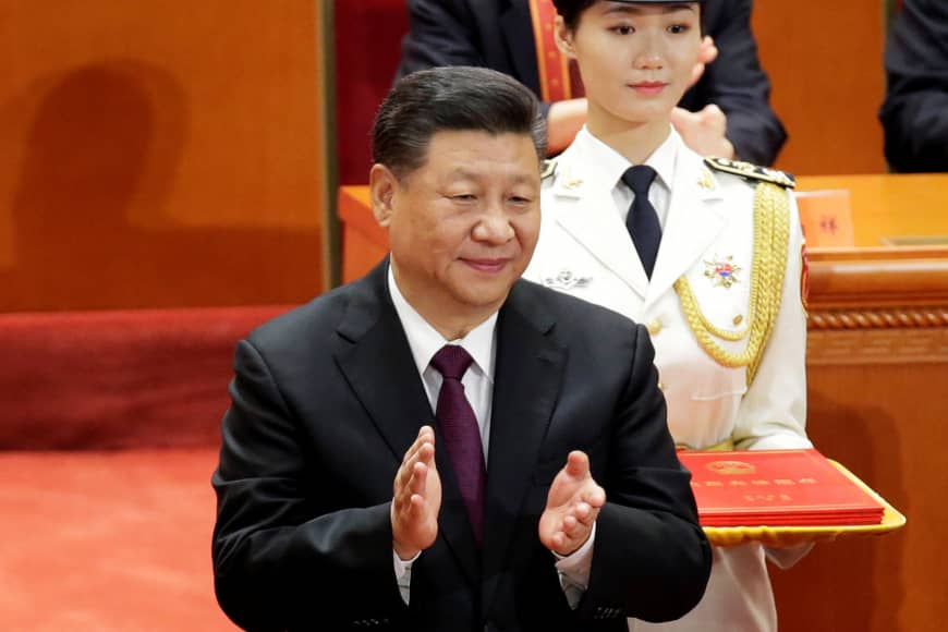 Chinese President Xi Jinping applauds at an event marking the 40th anniversary of China's reform and opening up at the Great Hall of the People in Beijing on Tuesday. | REUTERS