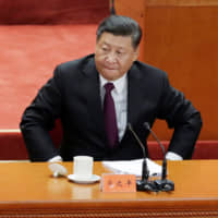 Chinese President Xi Jinping prepares to leave at the end of an event marking the 40th anniversary of China's reform and opening up at the Great Hall of the People in Beijing on Dec. 18. | REUTERS