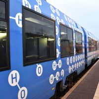"""The world's first passenger train powered by hydrogen fuel cells last year on Nov. 7 in Lower Saxony, northwestern Germany. The train is painted with the symbols for hydrogen and oxygen.   ‹?""""¯"""