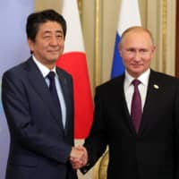 Shinzo Abe and Vladimir Putin tap foreign ministers to head territorial talks