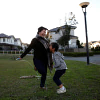 Mariko Hirose jumps rope with her son, Naohito, at a park in Higashinohara district of Inzai, Chiba Prefecture, on Nov. 1. | REUTERS