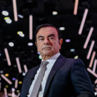 Going, going, Ghosn: Carlos Ghosn attends the Paris Motor Show in October. A month later, the Nissan Motor Co. chairman would find himself in a Tokyo jail. | BLOOMBERG