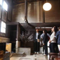 A kitchen in an old Japanese-style house in Sasayama, Hyogo Prefecture, is refurbished to function as a lobby after the vacant property was turned into a hotel. | CHUNICHI SHIMBUN