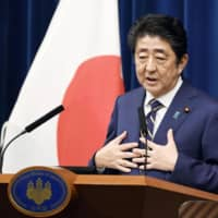 Prime Minister Shinzo Abe holds a news conference Monday following the closure of the Diet session earlier in the day. | KYODO