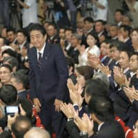 The long game: Prime Minister Shinzo Abe acknowledges the applause of other lawmakers from the ruling Liberal Democratic Party after being re-elected its president in September. | KYODO