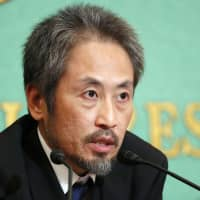 Journalist Jumpei Yasuda speaks at a press conference in Tokyo on Nov. 2. | KYODO